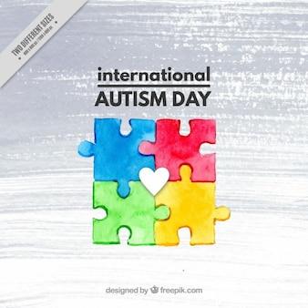 Piezas de acuarela de fondo del día del rompecabezas del autismo