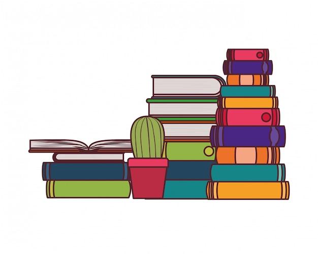 Pila de libros con planta de interior.