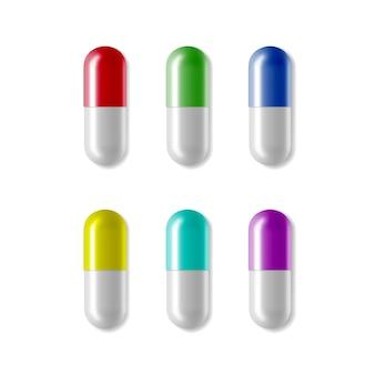 Píldoras médicas coloridas realistas, cápsulas realistas vectoriales aisladas