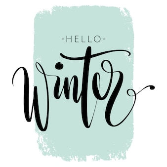 Pincel pluma letterng. hola invierno frase a mano sobre fondo colorido trazo.