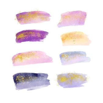 Pinceladas de acuarela pintadas a mano con oro y brillo.