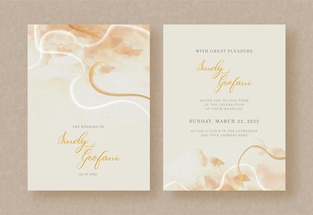 Pinceladas y salpicaduras de acuarela en invitación de boda