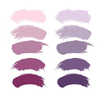 Pinceles de maquillaje, lápiz labial violeta nude o manchas de rubor. componer la colección de frotis.