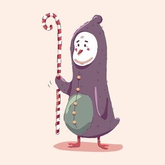 Pingüino de navidad con bastón de caramelo aislado sobre fondo.