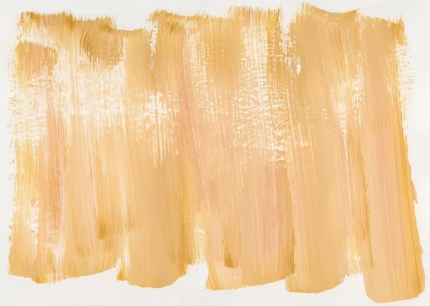 Pintura amarilla sobre lienzo.