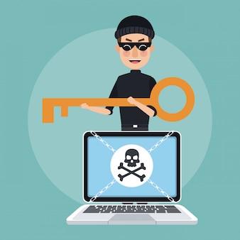 Pirata informático con la llave que desbloquea la computadora portátil con cadenas