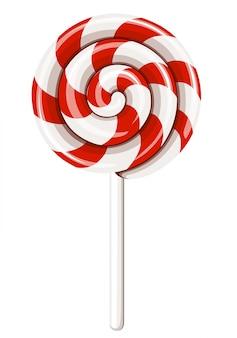 Piruleta espiral roja y blanca en el palillo. dulces navideños. sobre fondo blanco.