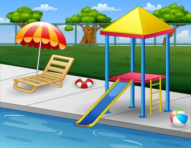 Piscina al aire libre con tumbona y tobogán