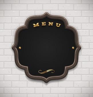 Pizarra de menú en marco de madera en pared de ladrillo blanco