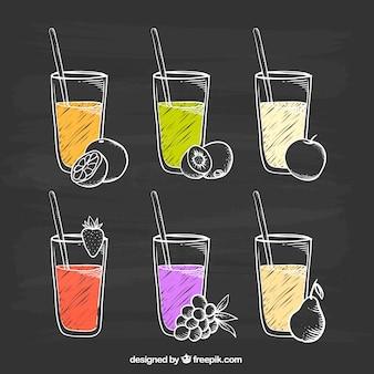 Pizarra con variedad de zumos de fruta