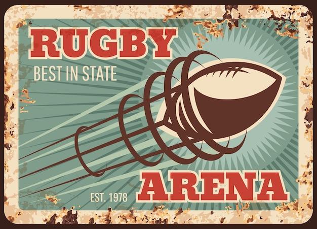 Placa de metal del deporte de rugby oxidada, pelota de fútbol americano en la arena, cartel retro.
