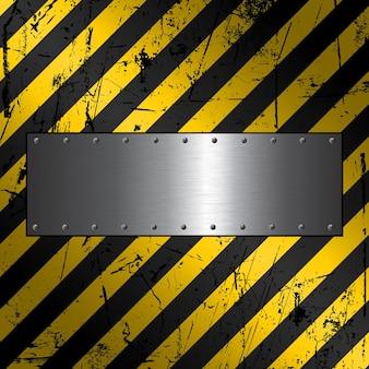 Placa de metal sobre un fondo de construcción grunge con textura