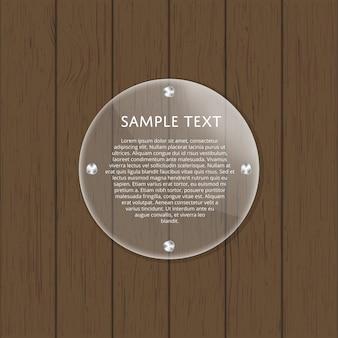 Placa redonda de vidrio sobre mesa de madera