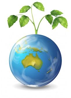 Planeta tierra con una planta verde en crecimiento.