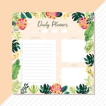 Planificador diario con fondo acuarela de plantas tropicales.