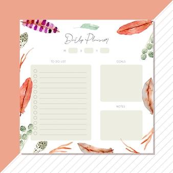 Planificador diario con plumas y hojas de fondo.