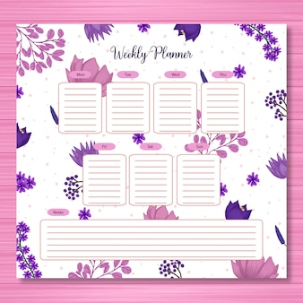 Planificador estudiantil con magníficas flores moradas