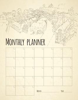 Planificador mensual con bocetos de la ciudad
