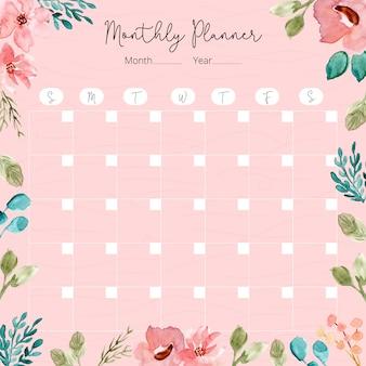 Planificador mensual con marco floral de acuarela.