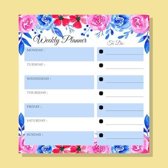 Planificador semanal azul y rosa con acuarela floral.