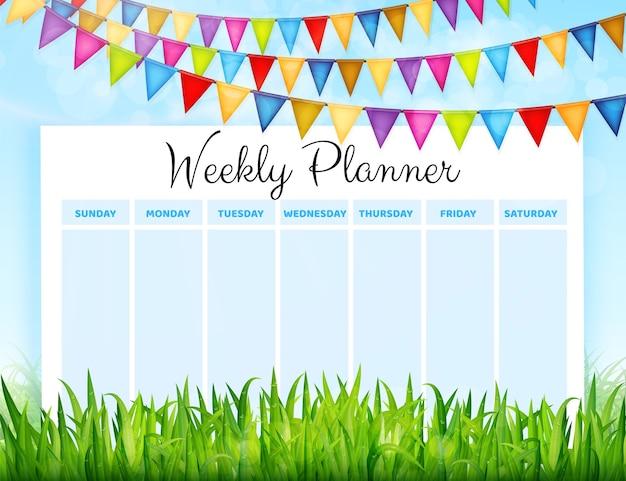 Planificador semanal con banderas de colores y fondo de hierba verde.