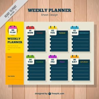 Planificador semanal con notas de papel