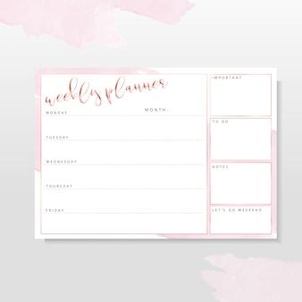 Planificador semanal de oro rosa con pinceladas rosadas