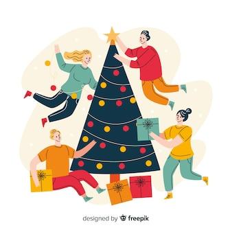 Plano árbol de navidad y gente decorando