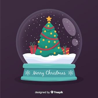 Plano árbol de navidad en globo de bola de nieve