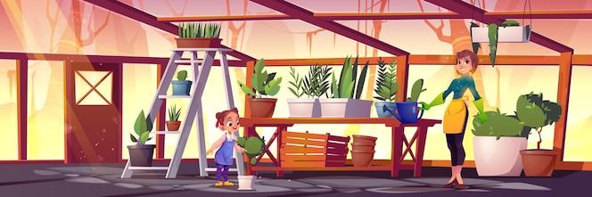Plantas de cuidado de mujer y niña en invernadero de vidrio