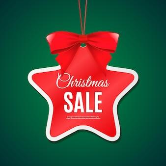 Plantilla de banner de etiqueta de venta de feliz navidad con etiqueta de estrella de lazo rojo y fondo verde vector eps10