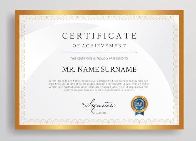 Plantilla de borde de certificado de logro dorado y azul con insignia tamaño a4