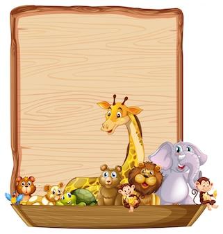 Plantilla de borde con lindos animales en bote de madera