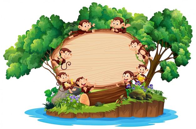 Plantilla de borde con muchos monos en la isla