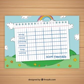 Plantilla de calendario escolar con cielo y arco iris