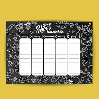 Plantilla de calendario escolar en el tablero de tiza con dino dibujado a mano.