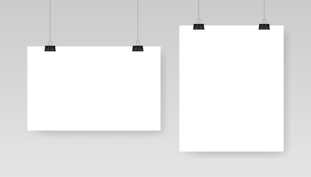 Plantilla de cartel blanco en blanco. affiche, hoja de papel colgando de un clip.