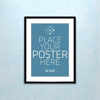 Plantilla de cartel de una hoja de papel en blanco en marco