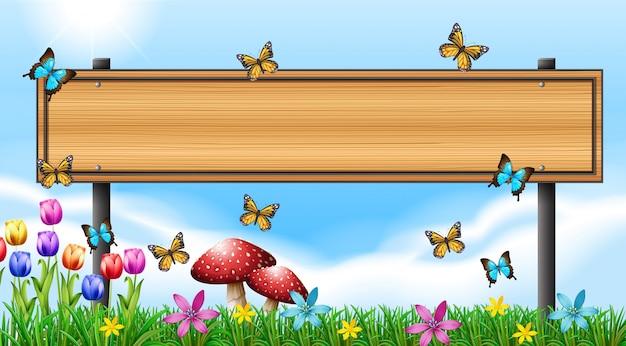 Plantilla de cartel de madera con mariposas en el jardín