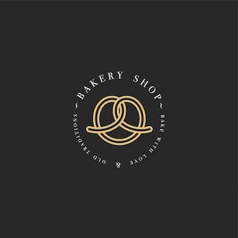 Plantilla y emblema - icono de hornear pretzel para panadería. tienda de dulces.