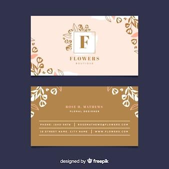 Plantilla floral con tarjeta de visita de líneas doradas