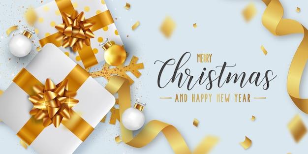 Plantilla de fondo de feliz navidad y próspero año nuevo con objetos navideños realistas