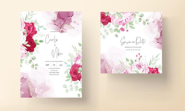 Plantilla de invitación de boda floral roja y rosa romántica con fondo de tinta de alcohol