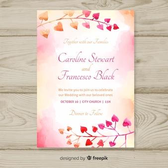 Plantilla de invitación de boda con hojas en acuarela