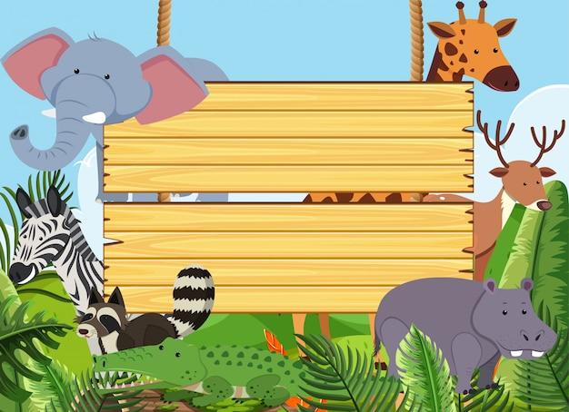 Plantilla de letrero de madera con animales salvajes en el parque