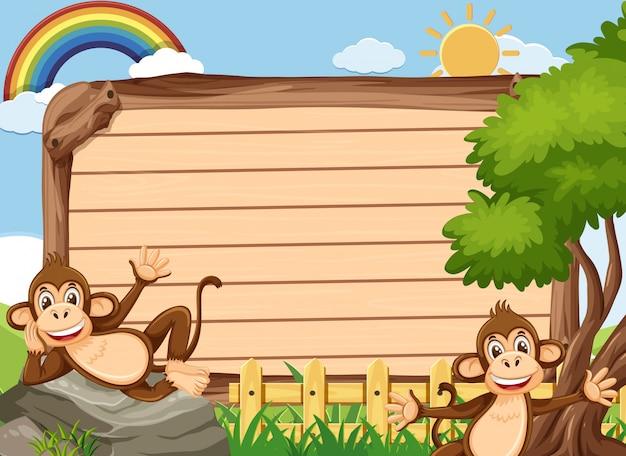 Plantilla de letrero de madera con dos monos en el parque