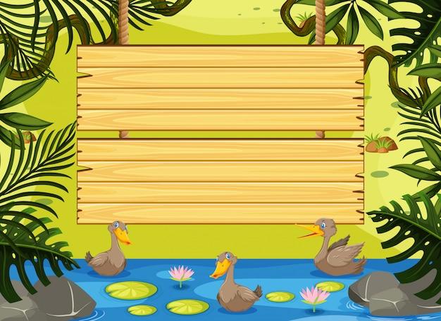 Plantilla de letrero de madera con patos en el río