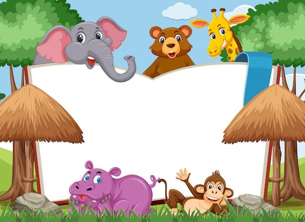 Plantilla de libro en blanco con animales salvajes en el parque
