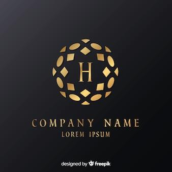 Plantilla de logo elegante dorado con adornos