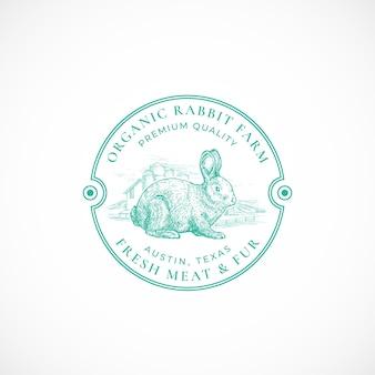 Plantilla de logotipo o insignia retro enmarcada de granja de conejos